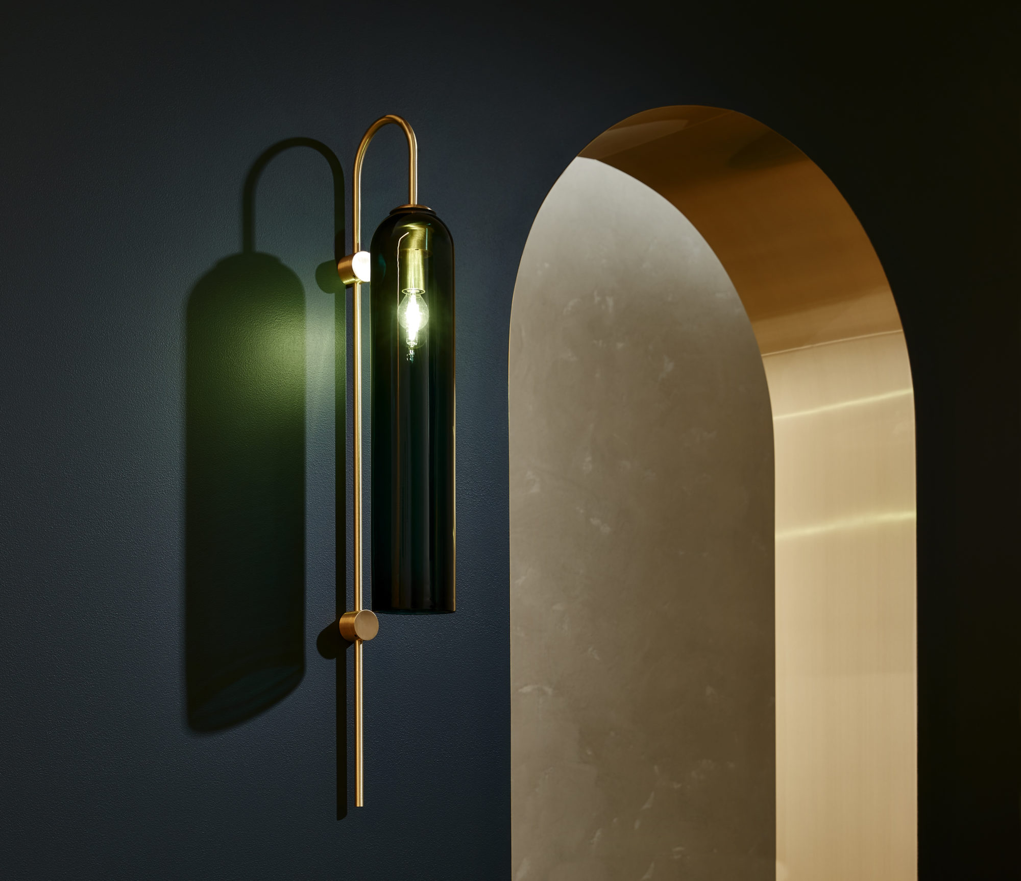 The simple silhouette of this refined glass and brass fixture adds a modern touch to any entryway