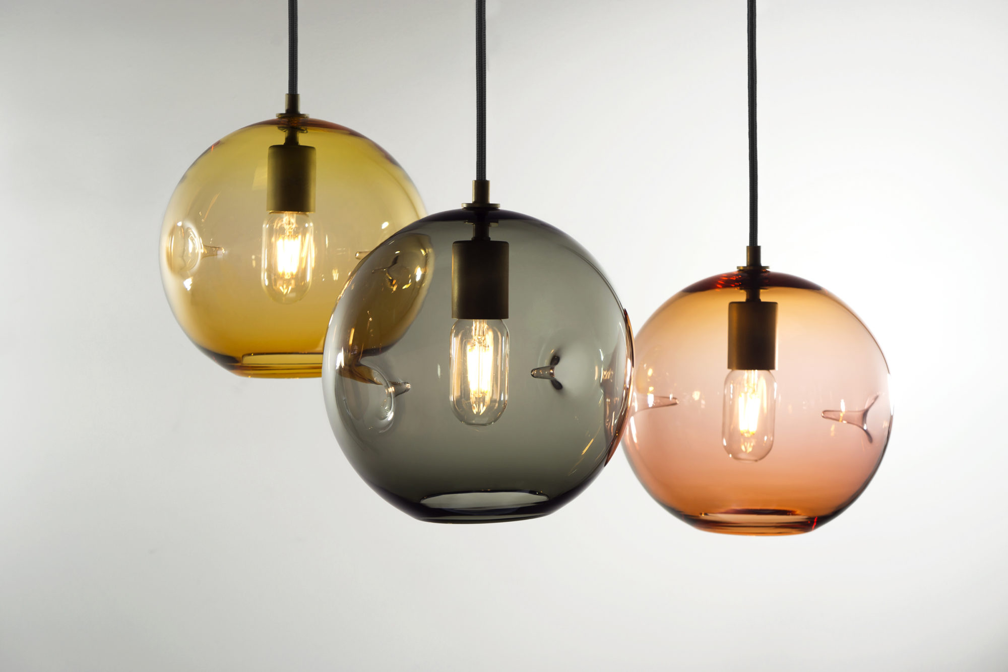 The six jewel inspired color options in this versatile fixture accentuate its signature feature each one is poked by hand on either side giving the glass